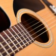 Stock Photo: Acoustic guitar with shallow depth of field