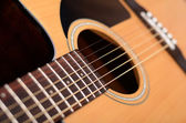Acoustic guitar with shallow depth of field — Stock Photo