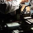 Man working on an old style lathe closeup — Stock Video