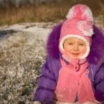 Portrait of happy little girl in snowy landscape — Stock Photo #37008581
