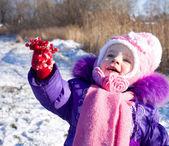 Portrait of happy little girl in snowy landscape — Stock Photo