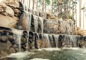 Waterfall with illuminating from beneath — Stock Photo