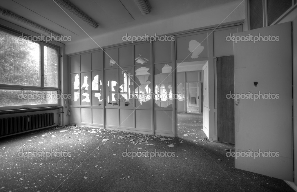 Abandoned empty office rooms with broken windows — Stock Photo #15345175