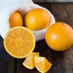 Постер, плакат: Oranges cut