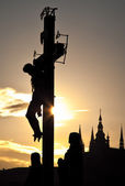 Jesus crucified on the cross at sunset — Stock Photo