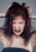 Angry girl with black lips — Stock Photo