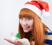 Beautiful smiling girl with a Christmas tree — Stock Photo