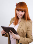 Young business woman with a Tablet PC — Stock Photo