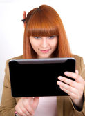 Young business woman enjoys a Tablet PC — Stock Photo