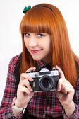 Portrait of a beautiful young red - hair female with old camera — Stock Photo