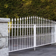Regal white metal gate — Stock Photo