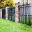 Brick and metal fence — Stock Photo
