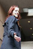 Businesswoman extending hand — Stock Photo