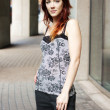 Pretty womstanding outside in sleeveless top — Stock Photo #16018169