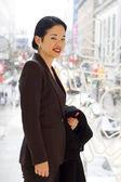 Pretty asian lady christmas shopping downtown — Stock Photo