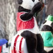 Bear sitting on drum set at christmas parade — Stock Photo #16283139
