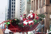 Santa Claus at christmas parade downtown -isolated — Stock Photo