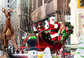 Santa Claus at christmas parade downtown — Stock Photo