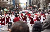 Pretty santas at christmas parade — Stock Photo