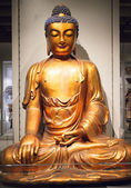 Giant bronze buddha at museum of anthropology — Stock Photo