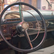 Steering wheel and dashboard from fifties automobile — Stock Photo #17849017