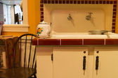 Retro kitchen sink and chair — Stock Photo