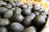 Avocados on display at market — Stock Photo