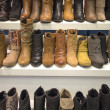 Stock Photo: Boots display on white shelf