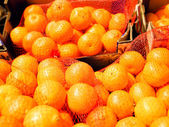Bagged mandarin oranges — Stock Photo