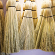 Stock Photo: Brooms hanging on wall