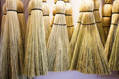 Brooms hanging on wall — Stock Photo