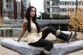 Woman sitting on curvy carved stone bench — Stock Photo