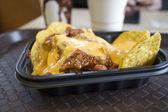 Nacho chips with chili and cheese — Stock Photo