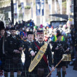 Pipe band at st. patricks's day parade - Stock Photo