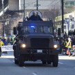 Stock Photo: Armored police vehicle at st. patrick's day parade