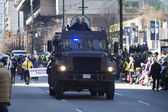 Armored police vehicle at st. patrick's day parade — Stock Photo