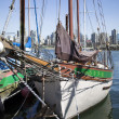 Sailboat resting by the pier - Stock Photo