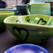 Green ceramic bowl - Stock Photo