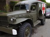 Retro military ambulance in neighborhood — Stock Photo