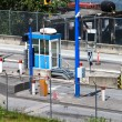 Tollbooth at oceanside roadway - Stock Photo