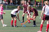 Girls playing field hockey — Stock Photo