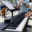 Groovy playing piano at outdoor fest — Stock Photo