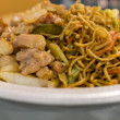 Szechuan chicken chow mein — Stock Photo