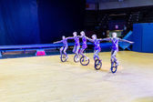 Circus kids performing on unicycle — Stock Photo