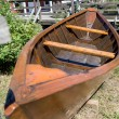 Old rowboat on lawn — Stock Photo