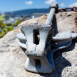 Anchor on seaside rock — Stock Photo