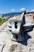 Anchor on seaside rock — Foto Stock
