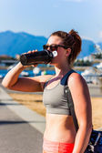 After workout drink from water bottle — Stock Photo