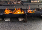 Barbecue pit on street — Stock Photo