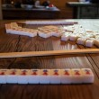 图库照片: Mah jong game on old table